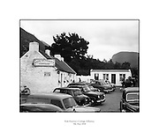 "Kate Kearney's Cottage, Killarney.05/05/1958..Kate was a beauty in Ireland before the Famine. At this cottage, Kate made her famous potion ""Kate Kearney's Mountain Dew"", which was illegal. She found ways to twart the law though. ..http://www.katekearneyscottage.com/history.html"