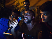 Mehmet Yazici, 23, reads a nationalist poem aloud at his going-away party the night before he leaves for basic training in the Turkish military.