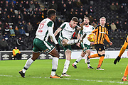 Barnsley FC midfielder Joe Williams (4) clears ball during the EFL Sky Bet Championship match between Hull City and Barnsley at the KCOM Stadium, Kingston upon Hull, England on 27 February 2018. Picture by Ian Lyall.