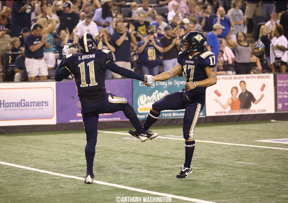 Baltimore Mariners wide receiver Scorpio Brown (No.11) and kicker J.R. Cipra celebrate following a successful field goal during AIFA Bowl IV at the 1st Mariner Arena on Sunday, July 25, 2010 in Baltimore, MD.