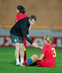 LLANELLI, WALES - Saturday, September 15, 2012: Wales' manager Jarmo Matikainen consoles Sophie Ingle after losing 2-1 to Scotland during the UEFA Women's Euro 2013 Qualifying Group 4 match at Parc y Scarlets. (Pic by David Rawcliffe/Propaganda)