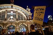 Frankfurt am Main | 21 Apr 2015<br /> <br /> Am Dienstag (21.04.2015) hielt die rassistische und islamfeindliche Gruppe PEGIDA (Patriotische Europ&auml;er gegen die Islamisierung des Abendlandes) an der Hauotwache neben der Katharinenkirche in Frankfurt am Main eine Mahnwache unter dem Motto &quot;Wir sind wieder da&quot; ab. Die Kundgebung war wie immer mit Hamburger Gittern abgesperrt und von starken Polizeikr&auml;ften bewacht. Etwa 1000 Menschen nahmen an den Gegenprotesten teil.<br /> Hier: Gegendemonstranten mit einem Transparent mit der Aufschrift &quot;Refugees Welcome&quot; bei einer Spontandemo nach Ende der Pegida-Kundgebung Hauptbahnhof, bei dieser Demo ging es um Flucht und Fl&uuml;chtlinge.<br /> <br /> &copy;peter-juelich.com<br /> <br /> [Foto Honorarpflichtig | No Model Release | No Property Release]