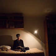 Hermit Sister Rachel Denton reads in her bed at St Cuthberts' Hermitage in Lincolnshire, north east Britain September 25, 2015. Sister Rachel Denton has vowed to spend the rest of her life living as a consecrated hermit in the Catholic faith. A hermit is a person who chooses to live alone, with the intention of finding God. Rarely leaving her house she lives a life of prayer and solitude. However, she uses the internet and social media to share her experience and distance her self from physically interacting with society. REUTERS/Neil Hall