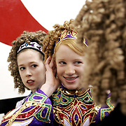 (wildart colwell 03/12/06) Hannah Bridigare-Curtis (left), 12, helps Laura Gavin, 14, adjust her head piece before performing at the Granville Irish Festival at Denison University, Sunday, March 12, 2006. The girls are dancers at Scoil Rince Ni Chiara school of Irish dance and were a main attraction at the festival. (dispatch photo by Tess Colwell)