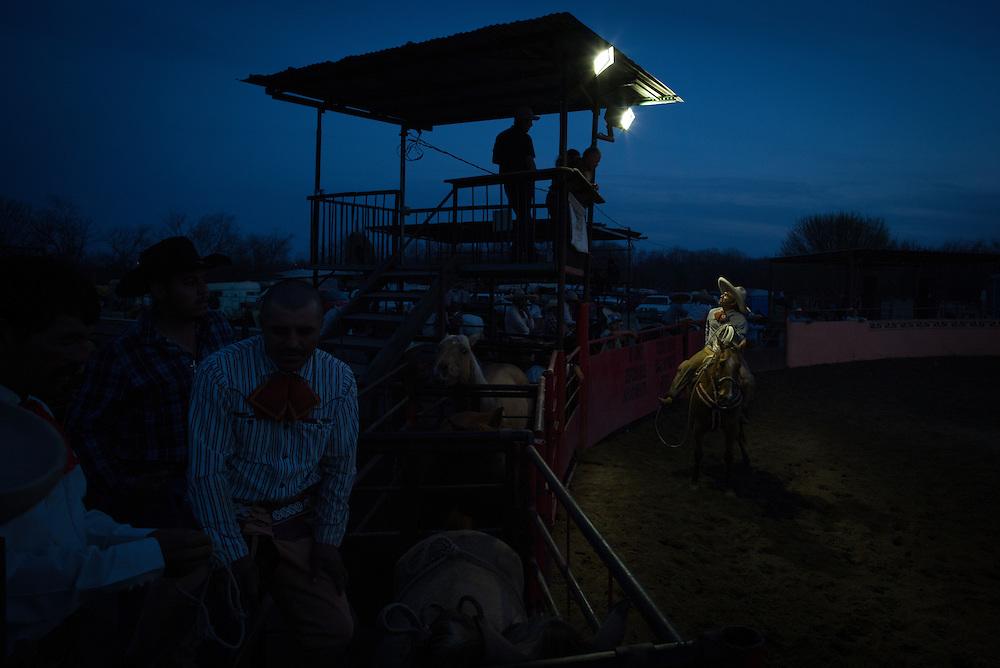 A contestant questions a judge's decison during a charreada at Lienzo El Bajio in Von Ormy, Texas.