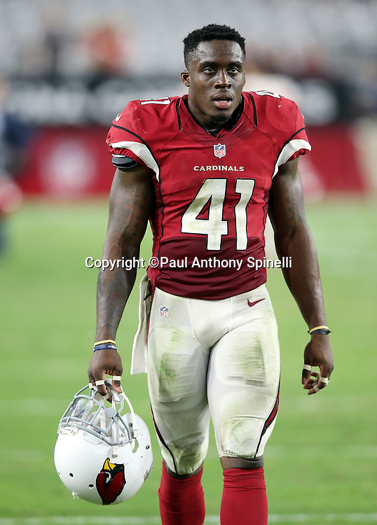 Arizona Cardinals safety Harold Jones-Quartey (41) walks off the field after the 2015 NFL preseason football game against the Kansas City Chiefs on Saturday, Aug. 15, 2015 in Glendale, Ariz. The Chiefs won the game 34-19. (©Paul Anthony Spinelli)