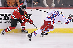 Mar 6; Newark, NJ, USA; New Jersey Devils defenseman Marek Zidlicky (2) trips New York Rangers right wing Brandon Prust (8) during the third period at the Prudential Center. The Devils defeated the Rangers 4-1.