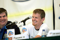 Floyd Landis of Phonak Hearing Systems speaks during a Ford Tour de Georgia press conference at the Marriott Hotel & Suites in Augusta, Ga., on Monday, April 17, 2006. This year's Tour de Georgia pro cycling race encompasses six stages over six days through the northern half of the state, plus a roll into southern Tennessee during the individual time trial. Next to Landis is Dan Rowe, the Deputy Commissioner of Tourism of the Georgia Department of Economic Development.<br />