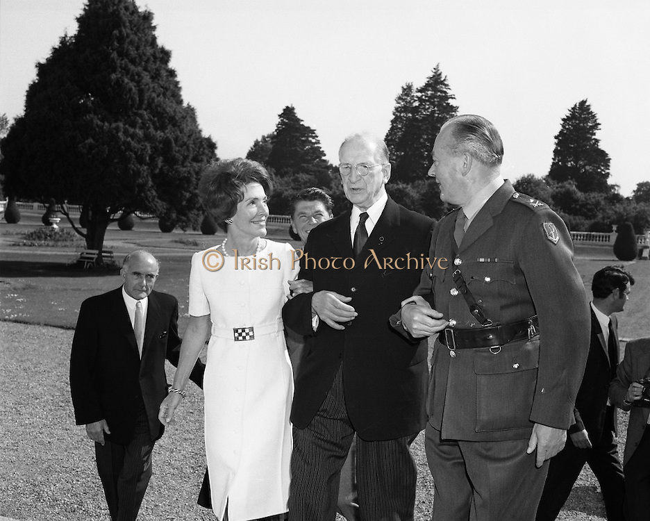 President DeValera Welcomes Governor Reagan..1972..18.07.1972..07.18.1972..18th July 1972..On his visit to Ireland,Governor Ronald Reagan of California,was greeted at Áras an Uachtaráin by the President, Mr Eamon DeValera. Governor Reagan was accompanied by his wife Nancy...President DeValera is pictured getting a helping hand to ascend the steps of  Áras an Uachtaráin from Mrs Nancy Reagan and Col Thomas McNamara,his Aide-de-Camp. Governor Reagan follows behind.