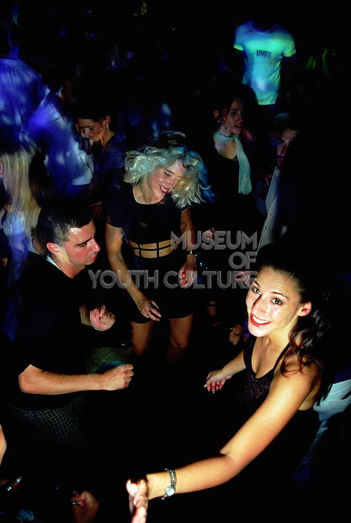 Group of people dancing at a rave, Hanover Grand. 1997.