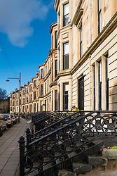 View of row of traditional sandstone tenement apartment buildings in Glasgow West End, Scotland, united kingdom