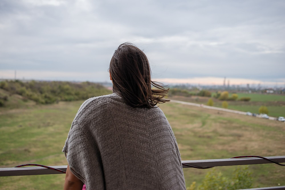 Rahela Petrescu, looks over the empty space which separates her apartment block and Bucharest. 'I was born and raised in the countryside. Here, from my balcony I can see sheep, goats, rabbits and various birds. I'm so happy to live here, at the edge. Each day I tell myself how happy I am.' Rahela lives in Confort City, a residential complex four km away from the Bucharest.