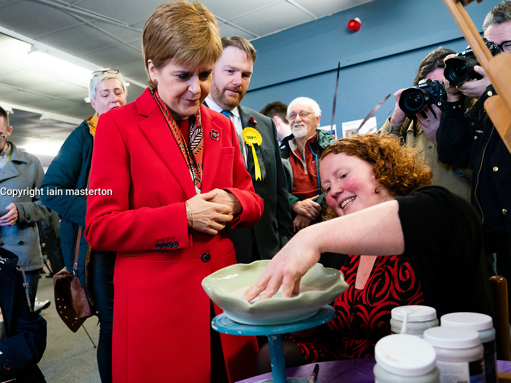 Dalkeith, Scotland, UK. 5th November 2019. First Minister Nicola Sturgeon joined Owen Thompson, SNP candidate for Midlothian, to campaign in Dalkeith at the One Dalkeith Community Hub where she met local artists and musicians. Nicola Sturgeon chats to local potter about her work. Iain Masterton/Alamy Live News.