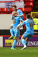 Thomas Kennedy of Barnsley (rear) celebrates scoring his team's second goal to make it 0-2 during the Sky Bet Championship match at The Valley, London<br /> Picture by David Horn/Focus Images Ltd +44 7545 970036<br /> 15/04/2014