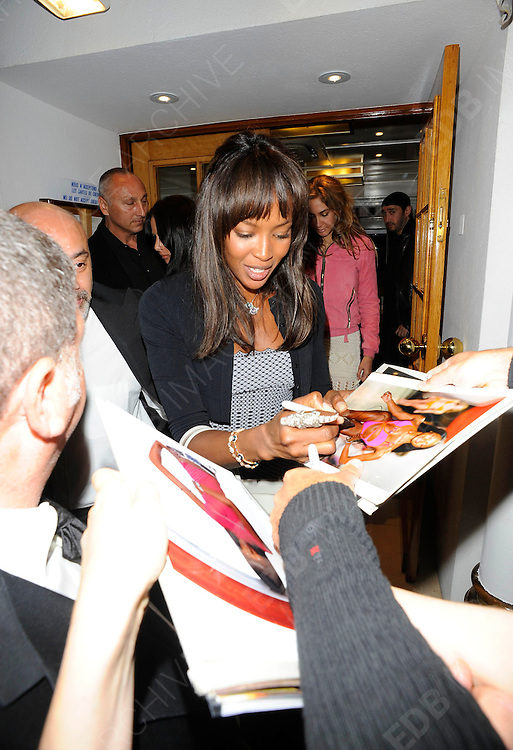 15.MAY.2011. CANNES<br /> <br /> MODEL NAOMI CAMPBELL AND HER HUSBAND VLADISLAV DORONIN DINE OUT TOGETHER AT TETOU RESTAURANT IN GOLF JUAN AS NAOMI EXITED THE RESTAURANT SHE SEEMED TO GET UPSET AT HER SECURITY FOR NOT OPENING THE CAR DOOR FOR A FRIEND DURING THE 64TH CANNES INTERNATIONAL FILM FESTIVAL 2011 IN CANNES, FRANCE<br /> <br /> BYLINE: EDBIMAGEARCHIVE.COM<br /> <br /> *THIS IMAGE IS STRICTLY FOR UK NEWSPAPERS AND MAGAZINES ONLY*<br /> *FOR WORLD WIDE SALES AND WEB USE PLEASE CONTACT EDBIMAGEARCHIVE - 0208 954 5968*
