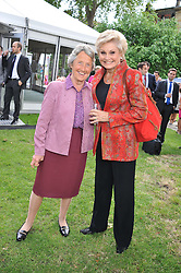 Left to right, BARONESS HEYHOE FLINT and ANGELA RIPPON at The Lady Taverners 25th Anniversary Westminster Abbey Garden Party held in The College Gardens, Westminster Abbey, London o 11th July 2012.