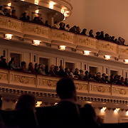 "December 12, 2012 - New York, NY : Concertgoers listen as conductor Gustavo Dudamel, not visible, leads the  Westminster Symphonic Choir and the Simón Bolívar Symphony Orchestra of Venezuela (not visible) as they perform Antonio Estévez's ""Cantata criolla"" at Carnegie Hall's Stern Auditorium / Perelman Stage on Tuesday evening.  CREDIT: Karsten Moran for The New York Times"