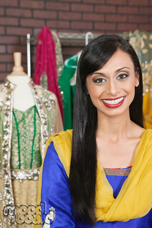 Portrait of a pretty Indian female dressmaker smiling
