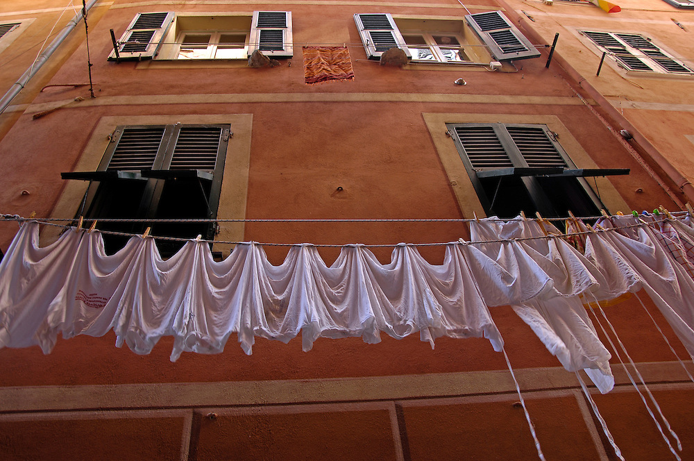 Clotheslines in narrow street in Camogli, Italy.