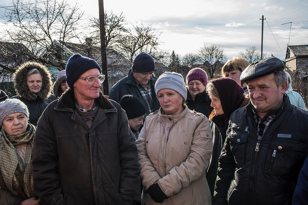 Local residents line up to receive free bread delivered by the Good Word Protestant Church in need on Thursday, December 10, 2015 in Mariinka, Ukraine.