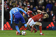 Arsenal forward Danny Welbeck (23) battles with Nottingham Forest defender Joe Warrall (42) during the The FA Cup 3rd round match between Nottingham Forest and Arsenal at the City Ground, Nottingham, England on 7 January 2018. Photo by Jon Hobley.