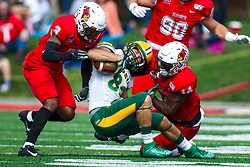 NORMAL, IL - October 05: Devin Taylor and Luther Kirk turn Cole Jacob in to a pretzel during a college football game between the ISU (Illinois State University) Redbirds and the North Dakota State Bison on October 05 2019 at Hancock Stadium in Normal, IL. (Photo by Alan Look)