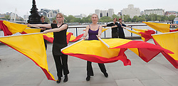© Licensed to London News Pictures. 31/05/2012. London, England. Rehearsal for the semaphore flags message to HM The Queen for the Thames Diamond Jubilee Pageant. Southbank Centre has commissioned Artist in Residence Lea Anderson to choreograph a new work - as the flotilla goes past Southbank Centre on 3 June, 30 dancers will be on the roof of the Royal Festival Hall to send HM The Queen a special message using semaphore flags in red and yellow. The message will spell out: Happy Diamond Jubilee Queen Elizabeth, We Heart Your. Photo credit: Bettina Strenske/LNP