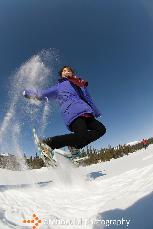 Woman jumping in snow shoes<br /> <br /> NOT IN YOUR BUDGET? Contact Cathie for a price specific to your project.