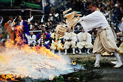 A Buddhist priest burns wooden prayer tablets on which the names of visiting pilgrims are written at a purification ceremony  in Takao, west of Tokyo, Japan on Sunday 09 March  2009. The ceremony culminates with dozens of monks and then pilgrims walking barefoot  across the burning embers.