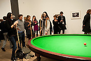 KATE TOMLINSON;  INDIA WATERS ;LILY COLE;  PLAYING Gabriel Orozco's 'Carambole with a Pendulum?  (an oval-shaped billiard table with no pockets ), Gabriel Orozco reception, Tate Modern, London. 18 January 2010. .-DO NOT ARCHIVE-© Copyright Photograph by Dafydd Jones. 248 Clapham Rd. London SW9 0PZ. Tel 0207 820 0771. www.dafjones.com.