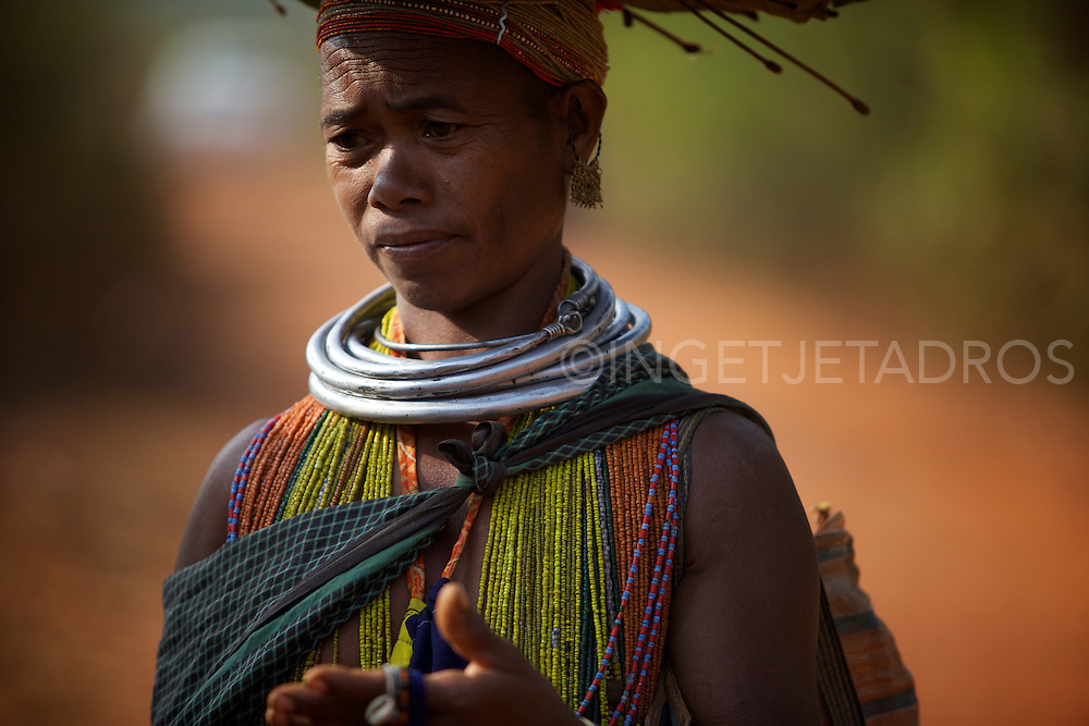 Bonda women wear large and thick brass or aluminium circular and countless colourful beads looped around their head and neck.<br />