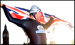 Comic Daivid Walliams waves the union Jack flag in Westminster, London, as he completes his 8 day swim of the River Thames, Monday September 12, 2011 Photo By Andrew Parsons/Parsons-Lock