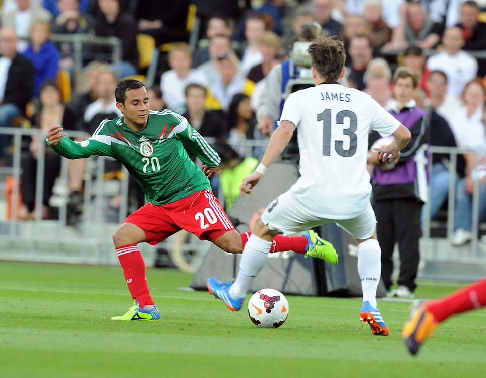 Mexico's Luis Montes, left, plays around New Zealand's Chris James in the World Cup Football qualifier, Westpac Stadium, Wellington, New Zealand, Wednesday, November 20, 2013.Credit:SNPA / Ross Setford