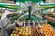 Like most Kuwaitis, including the man pictured here, Wafaa Al Haggan does most of her grocery shopping in one of the country's many Western-style supermarkets; in her case, a multistory market in a shopping center run by the government-subsidized Shamiya and Shuwaikh Co-operative Society. Although Kuwait imports 98 percent of its food, much of it from thousands of miles away, the choice and quality of the goods on display easily match those in European or U.S. markets, and the prices are lower. Hungry Planet: What the World Eats (p. 199).