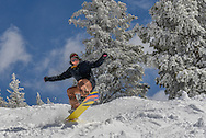 Aisha Bacos pops a wheelie in the glades on Aspen Mountain.