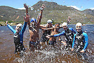 Jeremy Harris from KFM with young Development Swimmers before the start of the 200m Celebrity Splash held as part of the Bridge House Mile Swim at the Berg River Dam in Franschhoek on the 2nd November 2013<br /> <br /> Photo by Shaun Roy - WWF - Sportzpics