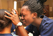 Nursing students conduct physical assesments on each other as part of their training at the College of Nursing at the University of Arizona, Tucson, Arizona, USA.  Andriece Dennus-Lucas, (left), is examined by Irene Owusu-Ankomah.