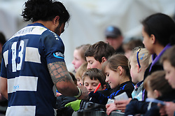 Bristol Outside Centre (#13) Fautua Otto signs autographs for Bristol Rugby fans - Photo mandatory by-line: Dougie Allward/JMP - Tel: Mobile: 07966 386802 07/04/2013 - SPORT - RUGBY - Memorial Stadium - Bristol. Bristol v Leinster A - B&I Cup.