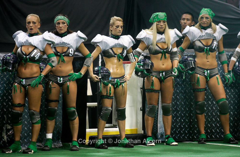 Nov 28, 2009 - Los Angeles, California, USA - Players for the Seattle Mist (2-0) Lingerei Football League stand on the sideline as pro football makes its return to Los Angeles as the Lingerie Football League (or 'LFL'), kicks-off in Los Angeles. The Lingerie Football League features some of America's most beautiful and athletic women playing 7-on-7 full-contact tackle football on Friday nights at major arenas and stadiums, as part of LFL, Friday Night Football.