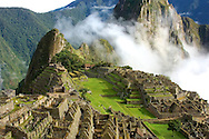 Clouds part to reveal the lost city of Machu Picchu.