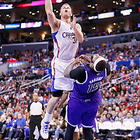 23 November 2013: Los Angeles Clippers power forward Blake Griffin (32) gets a charging foul while going for the layup against Sacramento Kings center DeMarcus Cousins (15) during the Los Angeles Clippers 103-102 victory over the Sacramento Kings at the Staples Center, Los Angeles, California, USA.