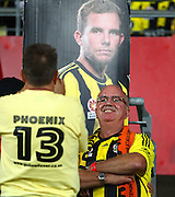 Paul Brockie in front of a picture of his son and ex Phoenix payer Jeremy Brockie during the Round 22 A-League football match - Wellington Phoenix V Adelaide United at Westpac Stadium, Wellington. Saturday 5th March 2016. Copyright Photo.: Grant Down / www.photosport.nz