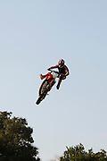 Freestyle Motocross Racer Performing Stunt