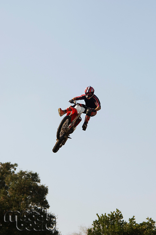 Freestyle Motocross Racer Performing Stunt