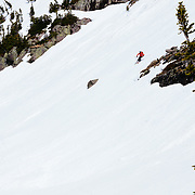 David Steele skis a line below Gunsight Peak in Glacier National Park.