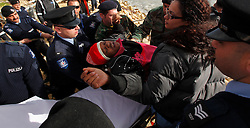 An African pregnant would-be immigrant is lifted onto a stretcher after arriving outside the fishing village of Marsaxlokk, on the south-east coast of Malta, February 1, 2009. A group of some 300 North African migrants landed in Malta early on Sunday in the biggest single arrival on the Mediterranean island in years.Police confirmed that the migrants had arrived on a boat near the fishing village of Marsaxlokk. ..
