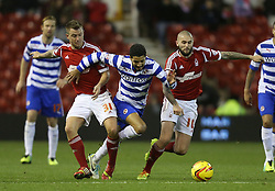 Reading's Jobi McAnuff is tackled by Nottingham Forest's Henri Lansbury and Simon Cox- Photo mandatory by-line: Matt Bunn/JMP - Tel: Mobile: 07966 386802 19/11/2013 - SPORT - Football - City Ground - Nottingham - Nottingham Forest v Reading - Sky Bet Championship