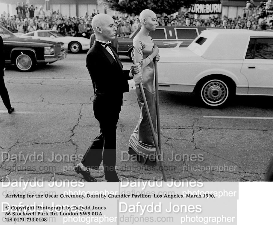 Arriving for the Oscar Ceremony. Dorothy Chandler Pavilion  Los Angeles. March 1990.<br /><br />© Copyright Photograph by Dafydd Jones<br />66 Stockwell Park Rd. London SW9 0DA<br />Tel 0171 733 0108<br />Film.90218/4