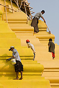 26 FEBRUARY 2008 -- MYAWADDY, MYANMAR: Workers clean a stupa at the Shwe Minn Wany temple in Myawaddy, Myanmar. Myawaddy, is just across the Moei River from Mae Sot, Thailand and is one of Myanmar's leading land ports for goods going to and coming from Thailand. Most of the businesses in the town are geared towards trade, both legal and illegal, with Thailand. Human rights activists from Myanmar maintain that the Burmese government controls the drug smuggling trade between the two countries and that most illegal drugs made in Myanmar are shipped into Thailand from Myawaddy.   Photo by Jack Kurtz