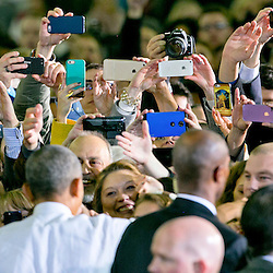Obama Boise<br /> Attendees use their phones to take pictures of President Barack Obama after a speech inside the Caven-Williams Sports Complex on the campus of Boise State University. Wednesday January 21, 2015<br /> AP PHOTO KYLE GREEN / THE IDAHO STATESMAN